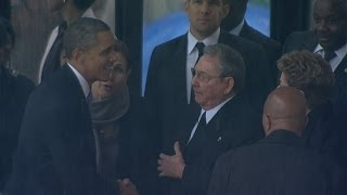 President Obama Shakes Hands With Cuba's Raul Castro At Nelson Mandela's Memorial