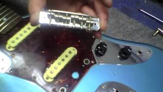 Nicks Drushel at Glaser Instruments points out common problems associated with bridges on Fender Jaguar and Fender Jazzmaster style guitars, and discusses ways to fix those issues.