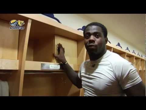 Football linebacker Clarence Bumpas gives a tour of the Bears' state-of-the-art team room