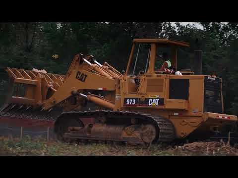 Cat 973 Track Loader Running Root Rake