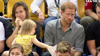 Watch This 2-Year-Old Girl Adorably Steal Popcorn From Prince Harry