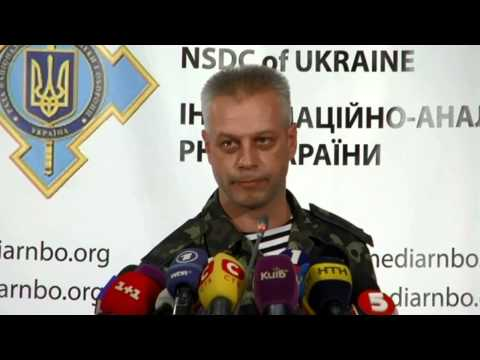 center - Col. Andriy Lysenko , Ukrainian National Security and Defense Council information center spokesman.