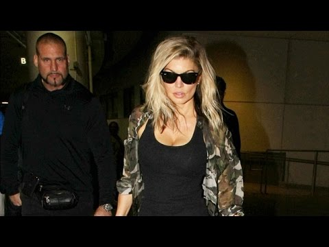 Fergie Struts Through LAX With Former Kardashian Bodyguard Pascal Duvier