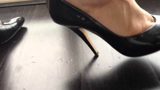 BLACK PATENT STILETTOS ON WOODEN FLOOR