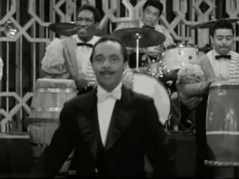mambo - from the 1956 movie cha cha cha boom...my father is the congero on the right....behind perez prado.