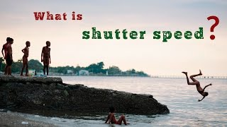 What is shutter speed? An explanation of how it can be used to freeze action, blur motion and take night shots. Also how it relates to light, exposure, stops, ISO and aperture for DSLR photography beginners.http://www.sydneyportraits.com.auhttp://www.greenwoodmedia.com.auWhat is shutter speed?Let's look at a couple of images:In this shot, we have long trailing lights. You can just make out a bus on the left and a car number plate. In this shot we have a boy frozen in mid air. How do we achieve these amazing effects?Yes, shutter speed!The basic concept of shutter speed isn't difficult to grasp but it helps if we first ask a fundamental question: what is a camera? Well, a camera is simply a light-proof box with a door (a shutter) that lets in light and then closes again. The shutter can be open for a long time – hours even. Or a very short time: down to a 1/8000ths of a second. Everything that happens in front of the camera during that time – be it hours or a tiny fraction of a second, will be recorded.There are no hard and fast rules about the exact shutter speeds to use in different situations. Afterall, few things move at the same speed all the time.But let's look at a few general examples:Portraits: generally I try not to shoot any slower than 1/125 of a second. This is usually fast enough to freeze slight facial movements. In this shot you can see that subject's face is sharp but there's a slight blur to his hands to indicate movement. Action: 1/400th of a second is fast enough to freeze this boy running. But if you look closely there's still a little blur on his fist. 1/1000 would have frozen that.It's great fun to experiment with shutter speed and water. Here's some handwashing at 1/400th of a second. And at 1/100th. I'm sure you know the classic long exposure waterfall shot – here's my more modest attempt – at 15 seconds.To freeze action you need a lot of light – so shooting on a bright, sunny day is perfect. Conversely, for a long exposure of seconds or minutes, low light – dusk or night time - is easier, although you can use a neutral density filter to reduce the amount of light entering the camera.Shutter speed, like ISO and aperture, is measured in 'stops' and works on the basis of doubles and halves. If you double the shutter speed by one stop from 1/125 to 1/250, you are halving the light entering the camera. To halve the speed from 1/1000 to 1/500, you are doubling the light. Shutter speed works in tandem with ISO and aperture. Assuming the light remains the same, if you change the shutter speed, you'll need to compensate either ISO or aperture. If you want to begin exploring shutter speed, it's probably best to start by using TV – shutter speed priority – mode. In this mode, you set the shutter speed and the camera decides the right aperture to get a correct exposure. Shutter speed is fun and the best way to master it is to go out and experiment. So bye bye and happy shooting!
