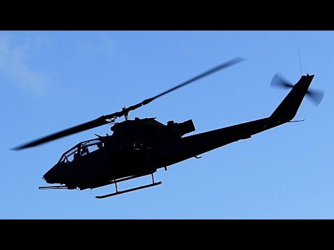 The AH-1 attack helicopter flying...
