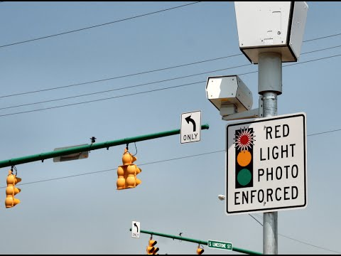 Lights - Confronted with questions about a flurry of red light camera tickets stamped with yellow times below the 3-second minimum, Mayor Rahm Emanuel's administration said the fluctuation of hundredths...