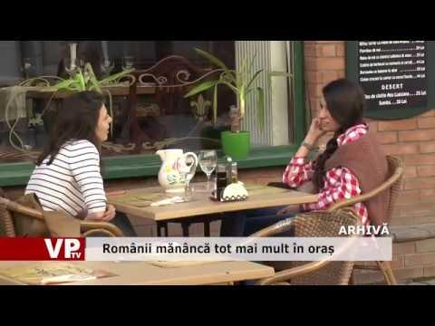 Românii mănâncă tot mai mult în oraș