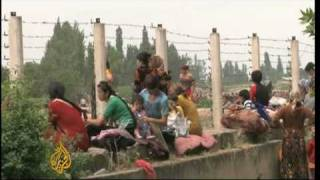 Subscribe to our channel http://bit.ly/AJSubscribe Thousands of ethnic Uzbeks are trying to escape southern Kyrgyzstan after...