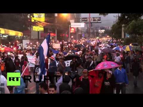 Honduras: US flag BURNS at torch-lit anti-corruption rally in Tegucigalpa