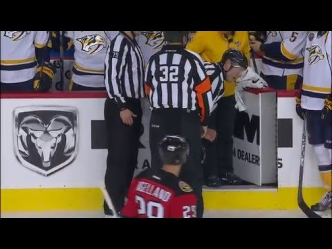 Dennis Wideman hits linesman Don Henderson