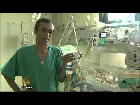 BABY - More than 30 houses in Gaza have been hit by airstrikes on Friday, while the death toll has reached over 860. But despite the growing number of deaths one unlikely survivor is a new born baby,...
