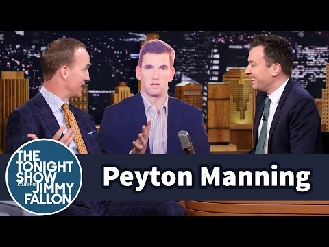 Peyton Manning talks to Eli's sad face