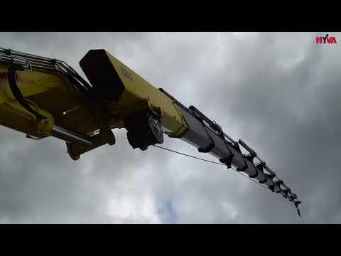 Grue Hyva HC 801X en pleine action sur des chantiers dans les Alpes