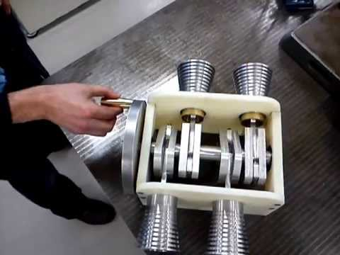 Flat four Engine - Here is our second year mechanical engineering project which required us to convert one form of motion into another form of motion. The mechanism was designe...