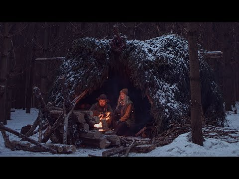Winter Camping in Bushcraft Shelter - Spruce Bough Bed, Long Log Fire, Camp Cooking