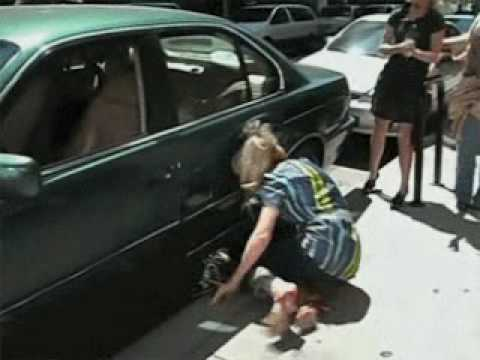 Girl runs into car door