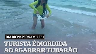 Turista paraibana leva mordida após agarrar tubarão para tirar selfie em Noronha