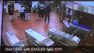 EAGLES fan knocking out GIANTS fan