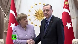 Визуальный контакт не удался: как прошла встреча Эрдогана и Меркель