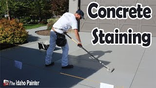"How to stain a concrete driveway with solid color concrete stains.  Making a cement or concrete driveway look new again.  Purdy XL Glide Brush:  http://amzn.to/2ehsylz1 gallon bucket grid:  http://amzn.to/2eCyHM42 gallon paint bucket:  http://amzn.to/2ehqgCMWooster 4"" roller:  http://amzn.to/2dRzaspPurdy White Dove roller covers:  http://amzn.to/2e8UV4B5 n 1 painters tool:  http://amzn.to/2diqzLmWooster 4-8' extension pole: http://amzn.to/2i0yKiuWooster 9"" roller: http://amzn.to/2hvij0gPurdy White Dove 9"" roller covers: http://amzn.to/2d8QlltWet paint signs: http://amzn.to/2tIYdXzWooster 5 gallon bucket: http://amzn.to/2hcG8HPRubber work gloves: http://amzn.to/2tEHymTHome improvement tips, tools, projects, hacks and more!  Oh, and how to paint a house for the DIY or professional painter.  You home repair headquarters.You can help support my channel by buying your tools and products in my Tool Store  http://theidahopainter.com/tool-store/My Paint Life paint wear is available in my shirt store: http://www.cafepress.com/idahopainterVisit me on Facebook for a chance to win a t-shirt.   https://www.facebook.com/theidahopainterThe Idaho Painter is brought to you by B&K Painting.  Visit us at http://www.idahopainter.comDisclaimer:Due to factors beyond the control of The Idaho Painter (or Chris Berry), I cannot guarantee against improper use or unauthorized modifications of this information. The Idaho Painter assumes no liability for property damage or injury incurred as a result of any of the information contained in this video. Use this information at your own risk. The Idaho Painter recommends safe practices when working on any structure and or with tools seen or implied in this video. Due to factors beyond the control of The Idaho Painter, no information contained in this video shall create any expressed or implied warranty or guarantee of any particular result. Any injury, damage, or loss that may result from use or improper use of these tools, equipment, or from the information contained in this video is the sole responsibility of the user and not The Idaho Painter."