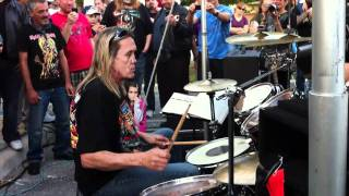 Awesome drum solo that gets rudely interrupted by a loud car...Nicko's reaction is priceless. Recorded at his restaurant Rock N ...