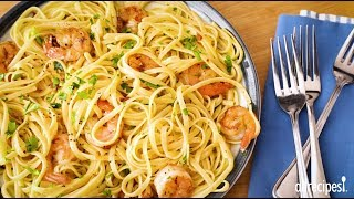 Get the recipe for Shrimp Scampi with Pasta at: http://allrecipes.com/recipe/229960/shrimp-scampi-with-pasta/ Impress your family on a weeknight or guests on the weekend with this elegant and supremely delicious seafood entrée! Warm up a sauce of butter, olive oil, shallots, garlic and red pepper flakes, then cook the shrimp in it. Add white wine, lemon juice and linguine and toss to mix up all the flavors. Dish up big bowls and get those forks a-twirling with enjoyment!Subscribe to Allrecipes @ http://www.youtube.com/subscription_center?add_user=allrecipesAllrecipes Magazine is now available!U.S. subscribers, subscribe here: http://armagazine.com/subscribenowCanadian subscribers, subscribe here: http://themeredithstore.ca/p-282-allrecipes-subscription.aspxFacebookhttp://www.facebook.com/AllrecipesTwitter @Allrecipes