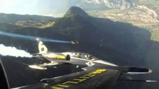 "A self-styled ""jet man"" has performed another death defying stunt - flying alongside two Albatross aircraft above the Swiss Alps."