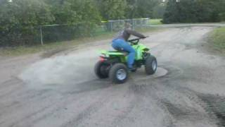 9. Ashlee riding a 90cc 4-wheeler
