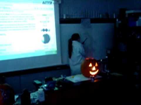 Amanda Frank blows up a pumpkin