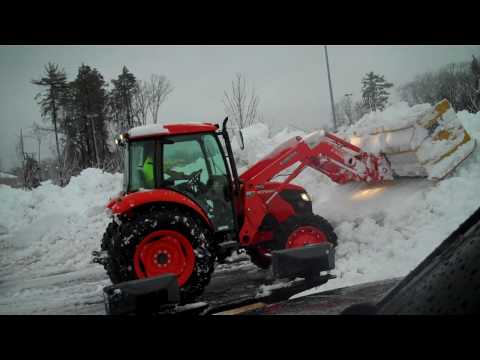 Kubota M7040 with 10 foot Pro-Tech Pushing snow