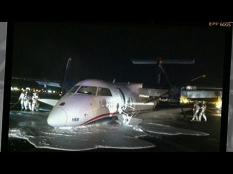 AT - Pilot forced to land plane without the use of landing gear.