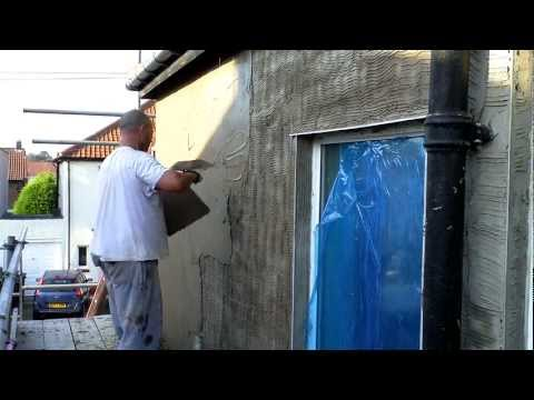 Plastering sand and cement rendering