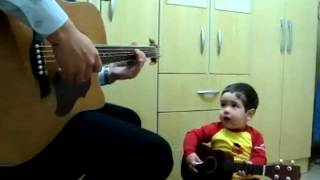 "Baby And Dad Playing ""Don't Let Me Down"""