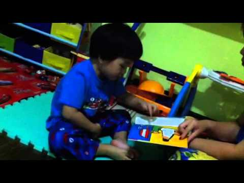 Asher reads Maisy Makes Gingerbread