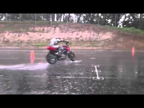 Wet surface motorcycle riding