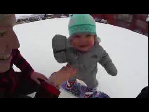 14 month old snowboarder hits the slopes