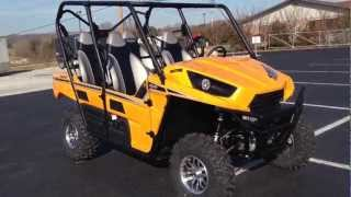3. 2013 Kawasaki Teryx4 750 4x4 EPS LE in Sunrise Yellow at Tommy's Motorsports