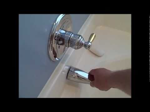 Home Inspector  Charlotte Shows bathroom tub faucet loose hot cold plumbing