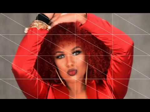 Natural Hairstyle with Red Hair Color from Sakeyta Roberts