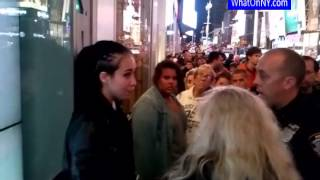 After girl and woman fighting Time Square  New York