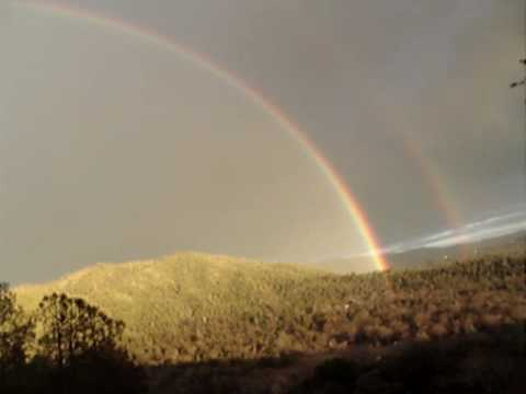 rainbows - It was rainbowing for at least an hour on January 8th 2010. It was incredible. The camera could not capture the vivid intensity and brightness. Look into the...