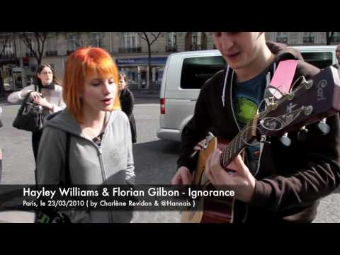 Man approaches lead singer of Paramore, Hayley Williams, with a guitar and kills it