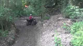 1. Aiden trying out his 4-wheeler, 2004 Polaris Sportsman 90