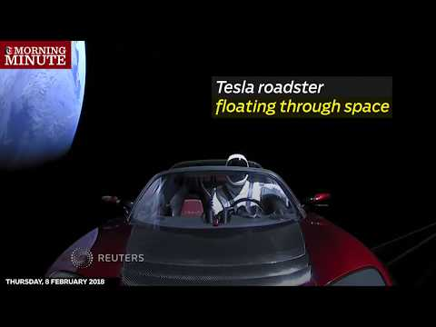 Billionaire entrepreneur Elon Musk's cherry red Tesla Roadster automobile floats through space after it was carried there by SpaceX's Falcon Heavy.
