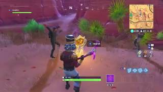 SEARCH BETWEEN AN OASIS, ROCK ARCHWAY, AND DINOSAURS CHALLENGE SPOT | FORTNITE BATTLE ROYALE