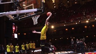 Kyle Guy switches hands while dunking at the McDonald's All-American Game