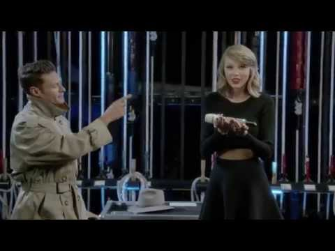 Off - iHeartRadio Music Festival show opener, Ryan Seacrest helps Taylor make her way to the stage!