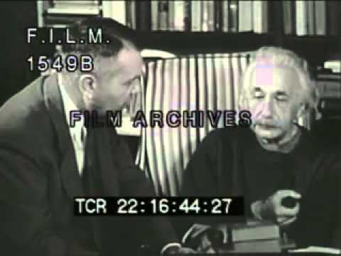 Albert - Albert Einstein talks about theory of relativity, graphics show equation E = MC squared (E=MC2); explains the theory of relativity. Einstein smoking pipe, re...